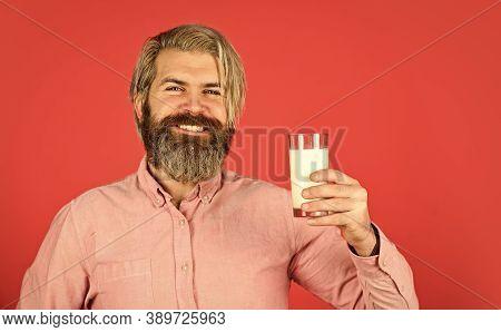 Useful Dairy Kitchen For Bone Health. Happy Farmer Present Milk Glass. Bearded Man Drink Useful Milk