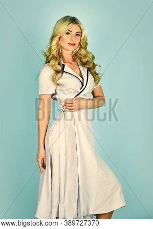 Pin Up Girl In Retro Dress. Stylish Vintage And Sexy. Clothes Shop. Beauty And Fashion. Curly Blonde