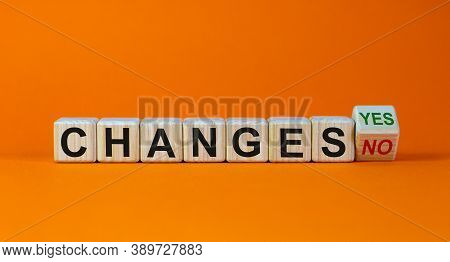 Turned A Cube And Changed The Expression 'changes No' To 'changes Yes'. Beautiful Orange Background.
