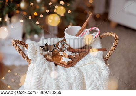 Christmas Decor. Mug, Christmas Candy, Christmas Cookies, Knitted Sweater, Wicker Basket Against The