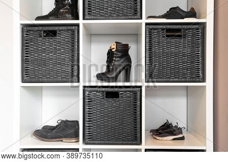 Organized Shoe Rack In Modern Interior, Various Footwear On Wooden Shelf, Storage For Shoes In A Mod