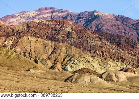 Arid Plateau Besides Barren Mountains Taken At The Mojave Desert In Death Valley, Ca