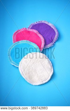 Four organic cotton reusable washable zero waste cleaning pads for make up removal in white blue pur