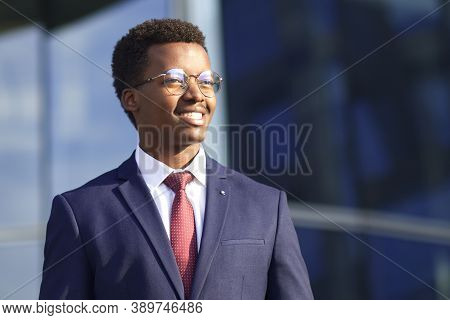 Portrait Of Handsome Happy Cheerful Positive Businessman In Formal Suit, Tie And Glasses. Black Afri