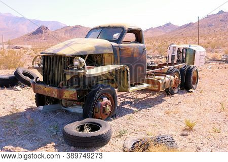 October 4, 2020 In Beatty, Nv:  Abandoned Classic Truck On A Desert Field At An Unofficial Community