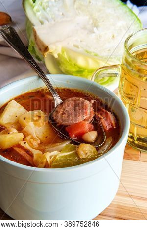 German Kielbasa Oktoberfest Stew With Cabbage Potatoes And A Beer Stein Glass Of Lager