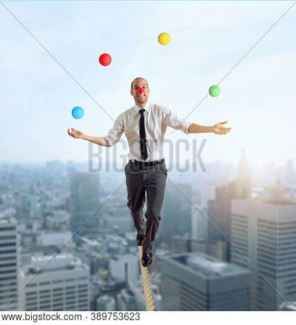 Worry Man In Balance Walking On A Rope Overand Acts Like A Juggler