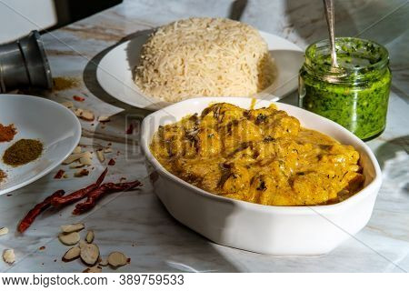 Authentic Indian Almond Chicken Korma Curry Dinner With Basmati Rice And Green Chutney