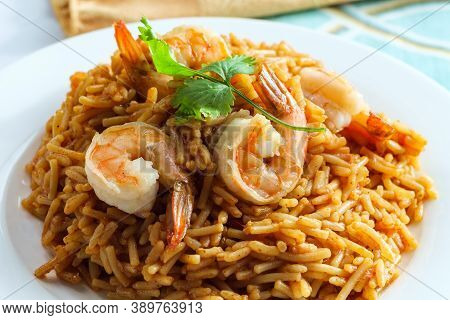 Tail-on Shrimp Spanish Rice With Vermicelli Pasta On Marble Kitchen Table