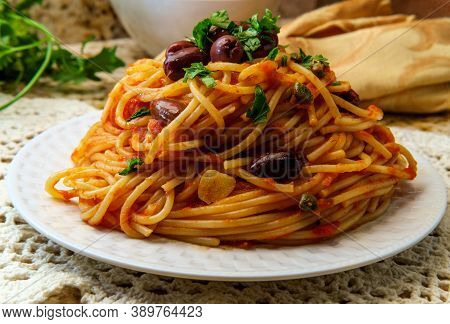 Delicious Italian Spaghetti Alla Puttanesca With Kalamata Olives And Capers
