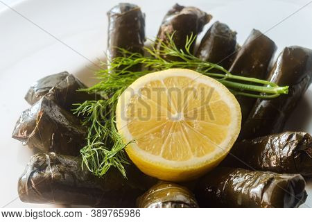 Armenian Yaprak Dolma, Stuffed Grape Leaves Garnished With Lemon And Fresh Dill