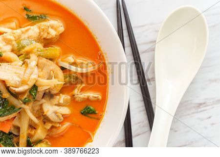 Thai Food Spicy Coconut Milk Panang Curry Soup With Chicken Snow Peas Onions And Spinach