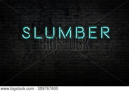 Neon Sign With Inscription Slumber Against Brick Wall. Night View