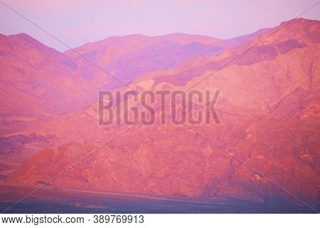 Sunset On Barren Mountains Taken At The Mojave Desert In Death Valley, Ca