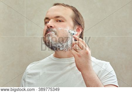 A 35-40 Year Old Man Shaves His Beard With A Safety Razor, Lifestyle