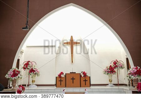Church Interior Decorated For Wedding Marriage Ceremony. Wedding Decoration In The Church.