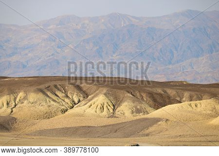 Arid Barren Mountains And Hills Taken At Rural Badlands In Death Valley, Ca