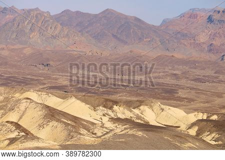 Barren Mountains And An Arid Plateau With Colorful Rocks Taken In Death Valley National Park, Ca