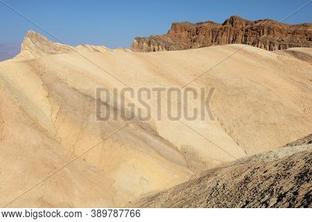 Barren Eroded Hills With No Vegetation Caused From Little Rain Taken On Arid Badlands At Zabriskie P
