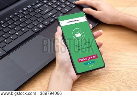 Female Using Mobile Smart Phone Online Confirm Payment For Online Shopping Mobile Payment. Concept B
