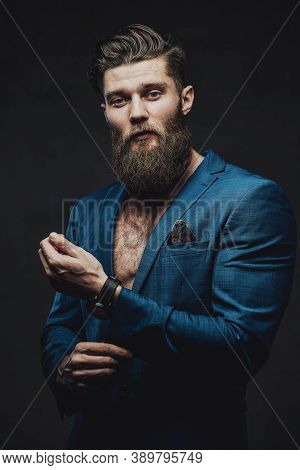 Styled And Handsome Businessman In Custom Blue Suite With Beard And Modern Haircut Posing Holding Hi