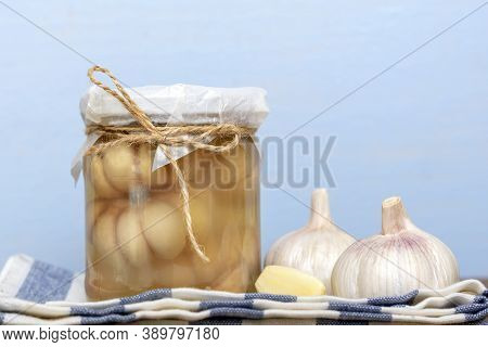 Marinated Garlic In Closed Glass Jar And Fresh On Wooden Table Healthy Fermented Food Homemade Pickl