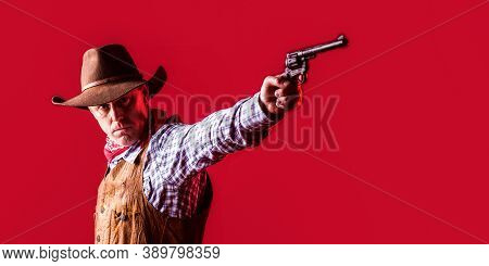 West, Guns. Portrait Of A Cowboy. American Bandit In Mask, Western Man With Hat. Portrait Of Cowboy