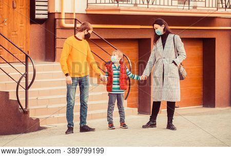 Family In Protective Mask, Medical Mask. Mom Dad And Sat Down Went For A Walk In Worn Masks. Family