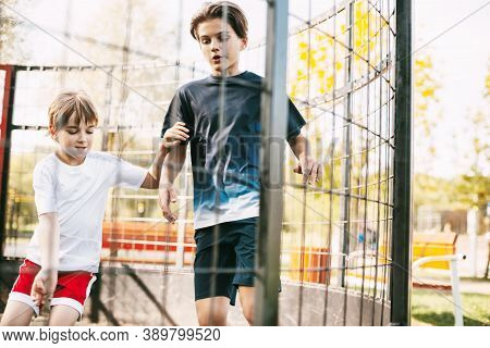 Two Cute Teenagers Play Soccer On The Freestyle Soccer Field. Boys Fight For The Ball In The Game. S