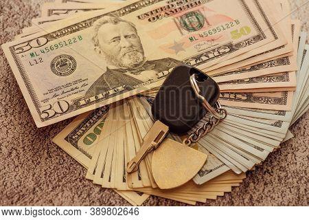 A Set Of Car Keys With Cash, Car Payment. Car Keys And Dollars