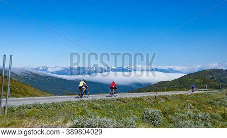 Vikafjellet, Norway - July 5, 2018: Group Of Cyclists On Road In Vikafjellet Between Vinje - Vik In