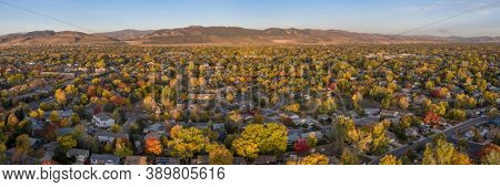 city of Fort Collins (residential area) and Front Range of Rocky Mountains in northern Colorado, aerial panorama in fall scenery
