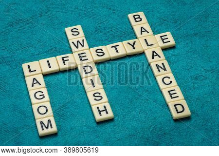 lagom crossword in ivory letters against textured paper, Swedish moderation and balanced lifestyle concept