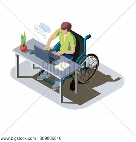 Man With Disabilities At Desk Working On A Computer. Invalid Person In A Wheelchair Doing Work Or Co