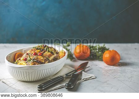 Roasted Pork In White Dish, Christmas Baked Ham With Cranberries, Tangerines, Thyme, Rosemary, Garli