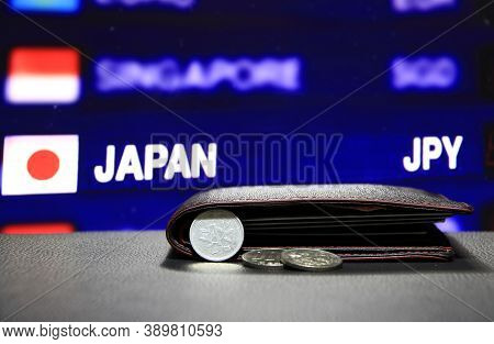 Japanese One Yen Coins On Obverse (jpy) And Pile Of Other Japanese Coins On Black Floor With Black W