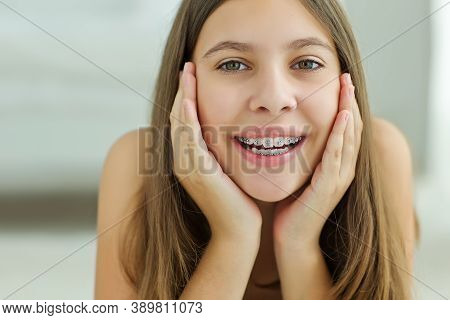 Close Up Portrait Of Smiling Teenager Girl Showing Dental Braces.isolated On White Background. High