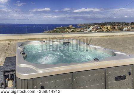 Modern Luxurious Pool With Hydromassage Overlooking The Town Of Santa Teresa Gallura, Located On The