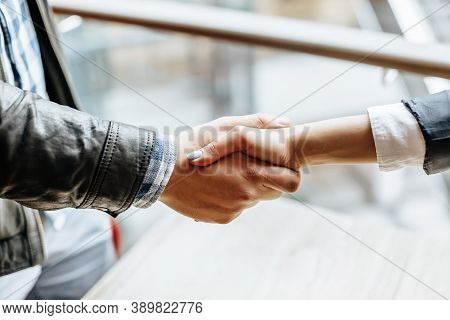 Man And Woman Hand Shaking. Handshake After Good Cooperation, Businesswoman Shaking Hands With Profe