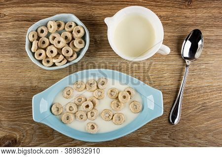 Small Oat Rings In Blue Oval Bowl With Yogurt, Bowl With Oat Rings, Pitcher With Yogurt, Metallic Sp