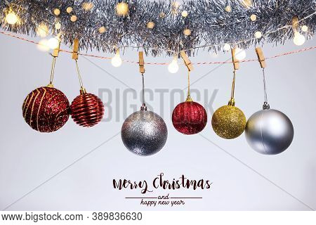 Christmas Decoration Balls And Ornaments Over Abstract Bokeh Background On White Background. Holiday
