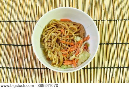 Fried Yakisoba Japanese Noodles Slice Pork And Cabbage With Carrot On Bowl