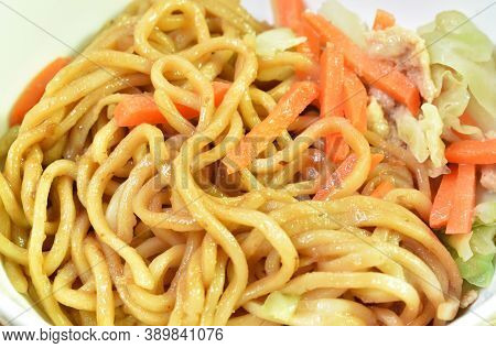 Fried Yakisoba Japanese Noodles Slice Pork And Cabbage With Carrot On White Bowl