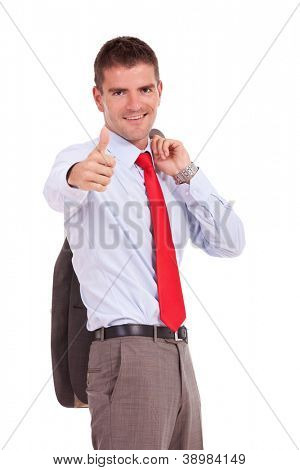 young business man holding his jacket and showing thumbs up