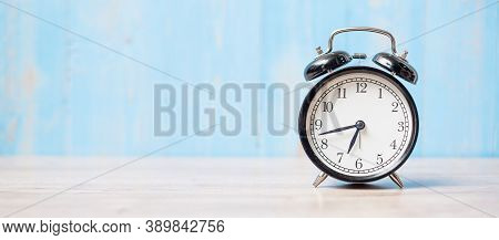 Alarm Clock On Wooden Table Background And Copy Space For Text. Activity, Morning, Workout And Work
