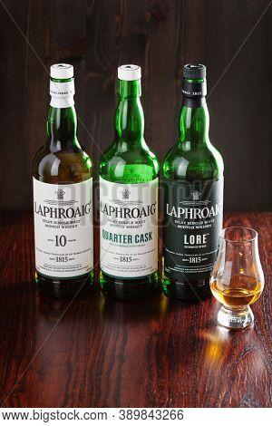 Trondheim, Norway - Mai 18 2020: Laphroaig single malt scotch whisky 10 years, quarter cask, lore bottle and glass