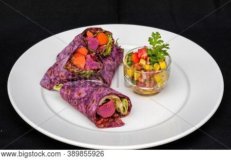 Homemade Sweet Potato Tortillas Wrap With Authentic Massaman Curry Serve With Mango And Tomato Salsa