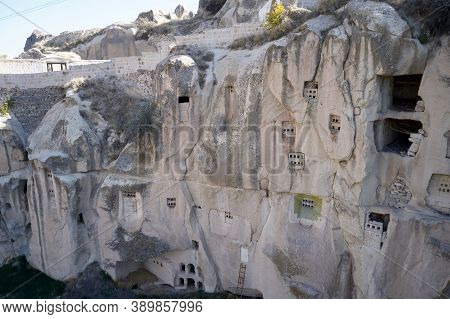 Archeology Background Of An Ancient Cappadocia Town. Old Rock-carved Cave House In Goreme Town.