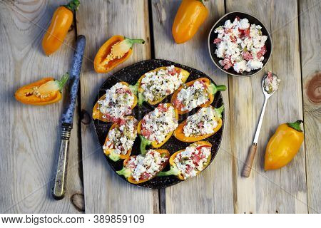 Yellow Bell Peppers Stuffed With Ricotta And Olives. Healthy Snack. Snack Diet. Autumn Cuisine. Stuf