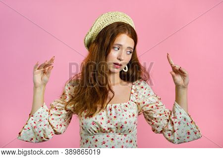 Cute Girl Showing Bla-bla-bla Gesture With Hands And Rolling Eyes Isolated On Pink Background. Empty